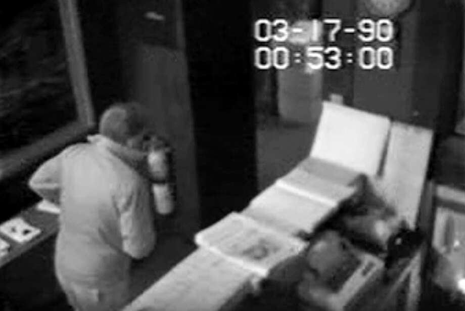 In a surveillance video released by the U.S. Attorney's Office, an unauthorized visitor enters the rear of the Isabella Stewart Gardner Museum in Boston on March 18, 1990, about 24 hours before the largest art heist in American History occurred there. The just-released video has again raised scrutiny on Richard Abath, the security guard then on duty at the Gardner. (Isabella Stewart Gardner Museum/U.S. Attorney's Office) Photo: ISABELLA STEWART GARDNER MUSEUM/U.S. ATTORNEY'S OFFICE / ISABELLA STEWART GARDNER MUSEUM/U.S. ATTORNEY'S OFFICE