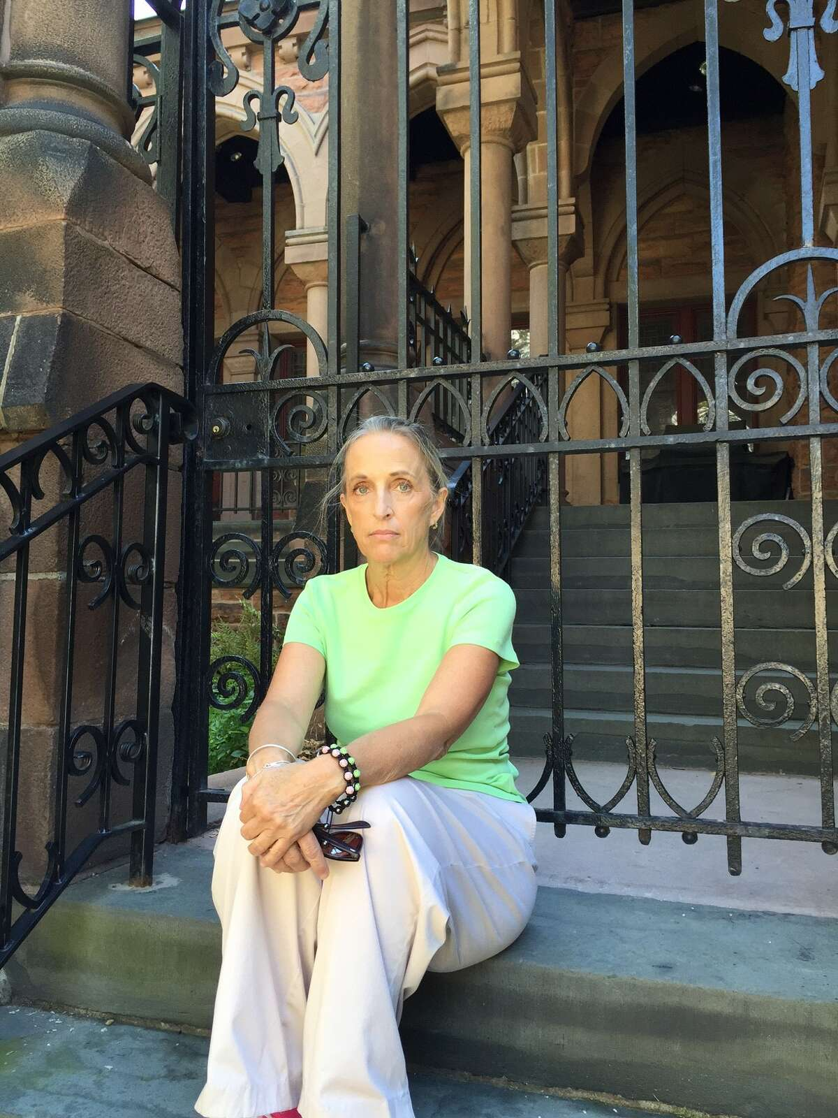 Alice Malavasic quit the Cathedral of All Saints, in the background, after more than 20 years after Bishop William Love's opposition to same-sex marriage. The bishop's position has caused a deep rift in the Albany Episcopal diocese. Malavasic and other parishioners drive to Bennington, Vt. to attend an Episcopal church that is more affirming of gays and lesbians than the Albany diocese. (Paul Grondahl / Times Union)
