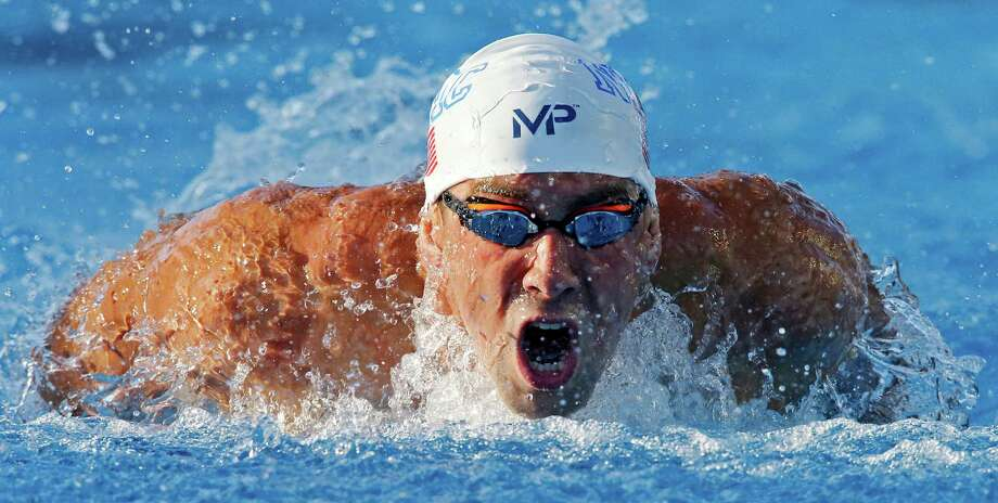 Michael Phelps competes in the men's 200-meter butterfly during the 2015 Phillips 66 National Championships held Friday Aug. 7, 2015 at the Northside Swim Center. Phelps finished first with a time of 1:52.94. Photo: Edward A. Ornelas, Staff / San Antonio Express-News / © 2015 San Antonio Express-News