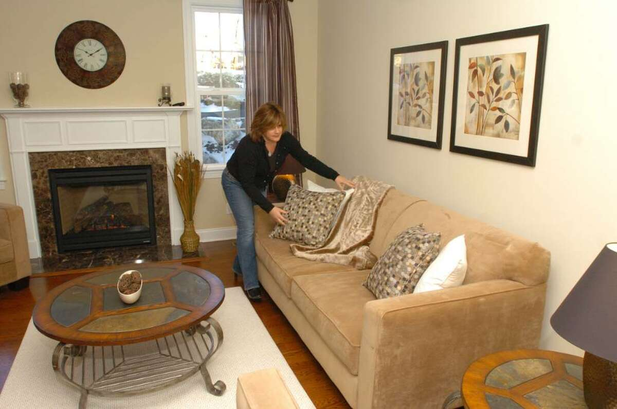 Patti Stern of PJ & Company Home Styling stages new town home at Bethel Meadows, in