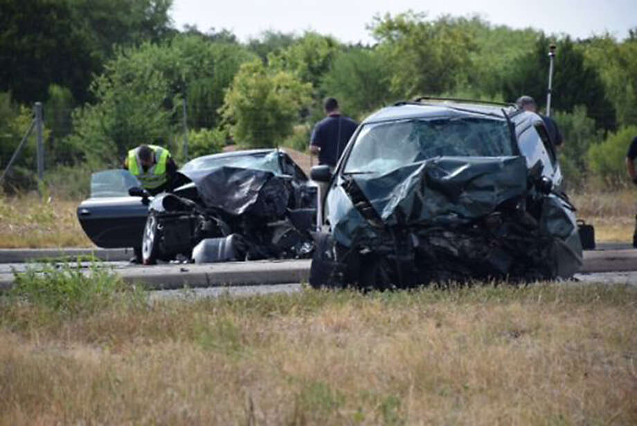 The minivan driver was taken to a hospital, but infor- mation on his condition was not available. Photo: Mark D. Wilson /San Antonio Express-News