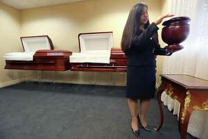 Bery Crispin, Assistant Vice President  talks about cremation urns on Monday, July 27, 2015 at Geo. H. Lewis & Sons Funeral Home in Houston, TX.  The story is about rising cremation rates, why more people are being cremated and what that means for companies and funeral homes.