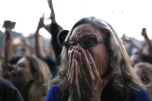 Megan Hill, 53, looks on in awe as Mumford and Sons takes the stage at Outsidelands in San Francisco, California, on Saturday, May 30, 2015. Photo: Brandon Chew, The Chronicle