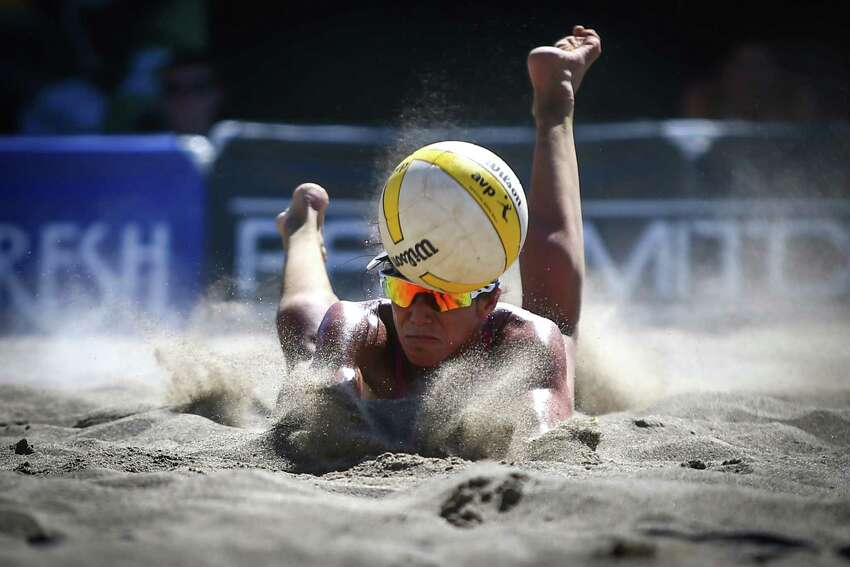 Lane Carico dives for the ball during the first day of the AVP Kingston Seattle Open, a pro beach volleyball competition that has drawn some of the best beach volleyball players in the sport. Olympic medal winners are included in the roster of top beach volleyball names competing over the weekend. The competition is being held at Lake Sammamish State Park. Photographed on Friday, August 7, 2015.