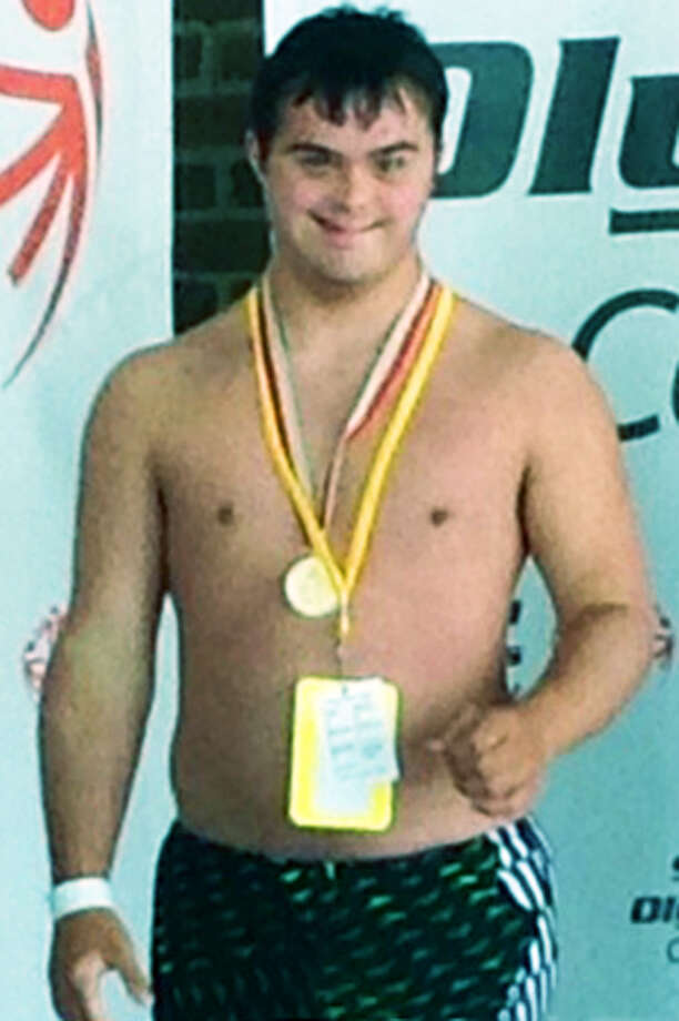 Ben Hannan of New Milford claims a gold medal in swimming during the recent state Special Olympics. Photo: Contributed Photo / Contributed Photo / The News-Times Contributed