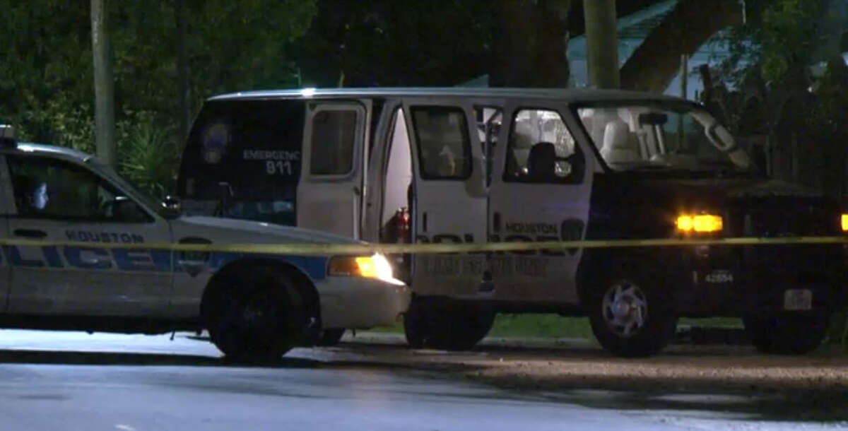 Police are searching for multiple shooters who injured one man, killed a second and shot at a third who had been sitting in a truck in northeast Houston.