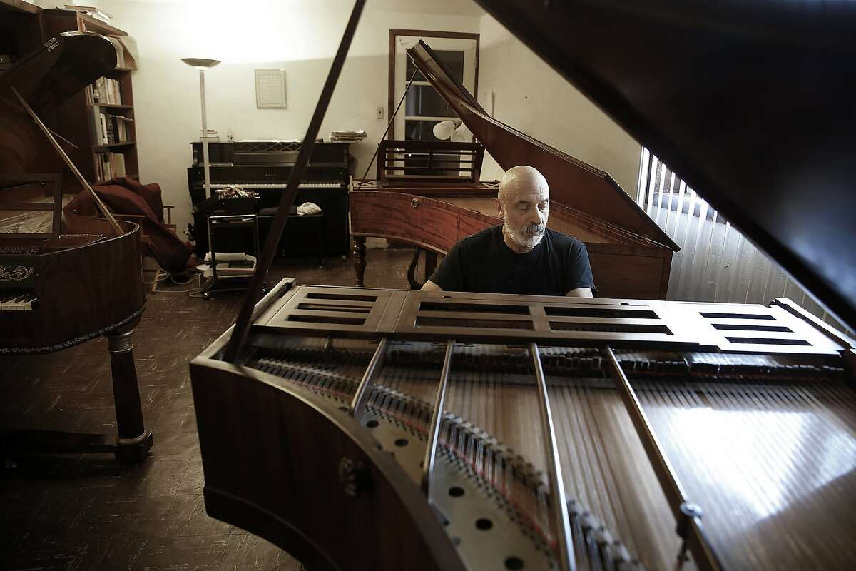 Keyboard performer John Khouri plays on an 1832 piano by John Broadwood & sons in his basement in Vallejo, Calif., on Wednesday, August 5, 2015.