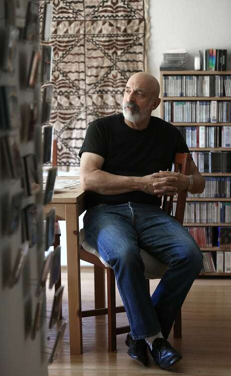 For the past seven years, keyboardist John Khouri has focused exclusively on making recordings, which he releases himself. The CDs are displayed on a wall in his home. Photo: Liz Hafalia, The Chronicle