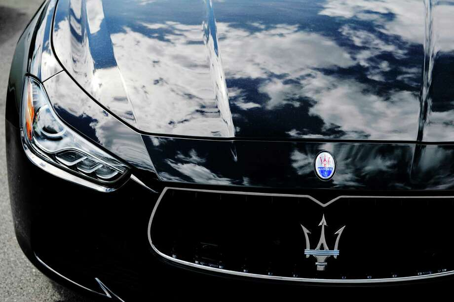 Clouds are reflected in the hood of a Maserati car on the lot at the new Maserati dealership at 1101 Central Ave., on Wednesday, Aug. 5, 2015, in Colonie, N.Y.  (Paul Buckowski / Times Union) Photo: PAUL BUCKOWSKI / 10032918A