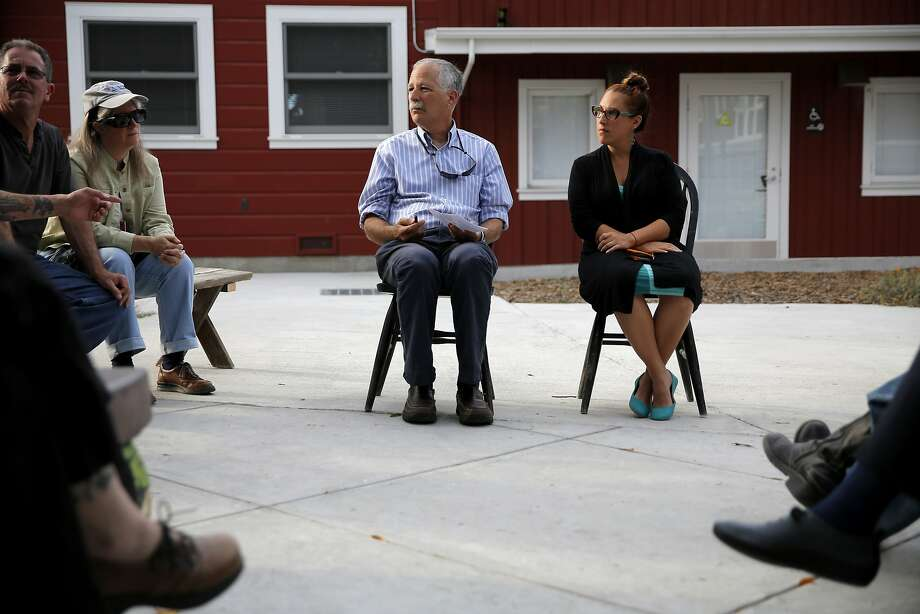 Santa Cruz mayor Don Lane (left) and city council member Cynthia Chase listen to a crowd of Tannery residents in Santa Cruz, California, on Wednesday, Aug. 5, 2015. Photo: Connor Radnovich, The Chronicle