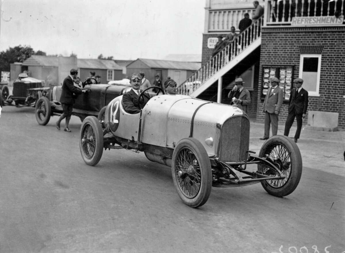 August 1922: Racing driver W G Barlow at the wheel of his Bentley at Brooklands race track.
