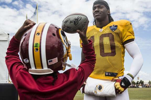 Washington Redskins quarterback Robert Griffin III (10) stands with his niece Jania Griffin following practice during Washington Redskins training camp with the Houston Texans at the Bon Secours Training Center on Saturday, Aug. 8, 2015, in Richmond, Va.  ( Brett Coomer / Houston Chronicle )