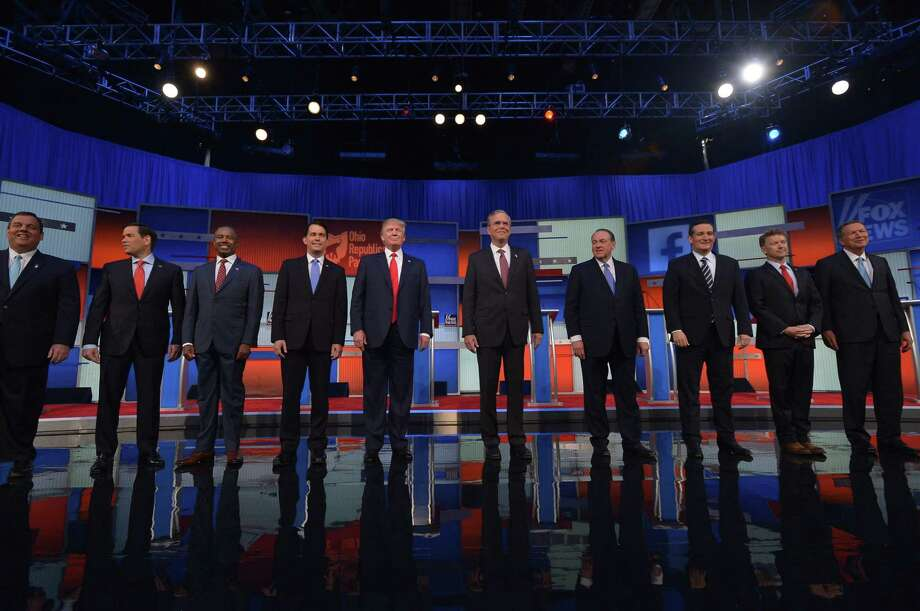 The top 10 Republican presidential hopefuls arrive on stage for the start of the prime time Republican presidential primary debate on August 6, 2015 at the Quicken Loans Arena in Cleveland, Ohio. AFP PHOTO/MANDEL NGANMANDEL NGAN/AFP/Getty Images Photo: MANDEL NGAN, Staff / AFP / Getty Images / AFP
