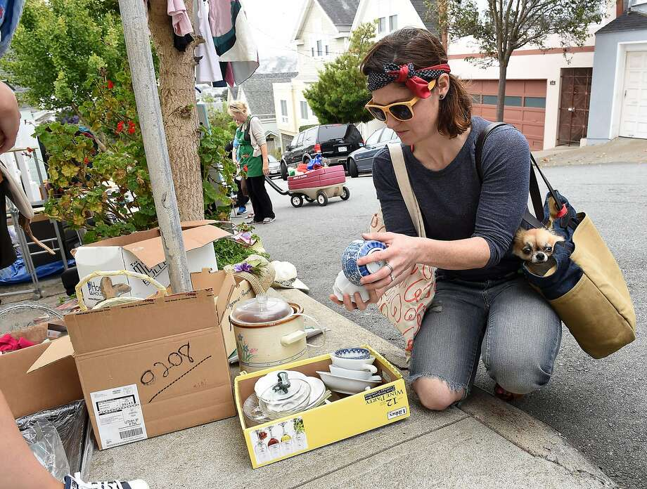 Suzanne Hanson looks at items on Andover Street in Bernal Heights on August 8, 2015. Over 100 participants held garage sales in the neighborhood. Photo: Susana Bates, Special To The Chronicle