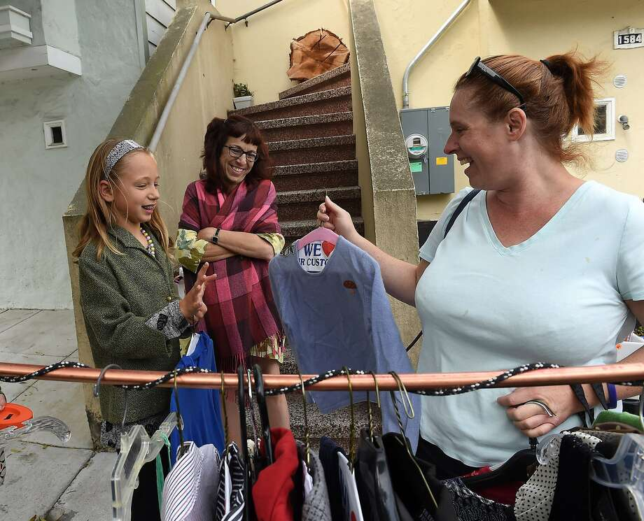 Ellery Singleton (left), Fran Culp, and Molly Glennen are seen at Fran's garage sale on Treat Avenue in Bernal Heights on Saturday, August 8, 2015. Over 100 participants held garage sales in the neighborhood. Photo: Susana Bates, Special To The Chronicle