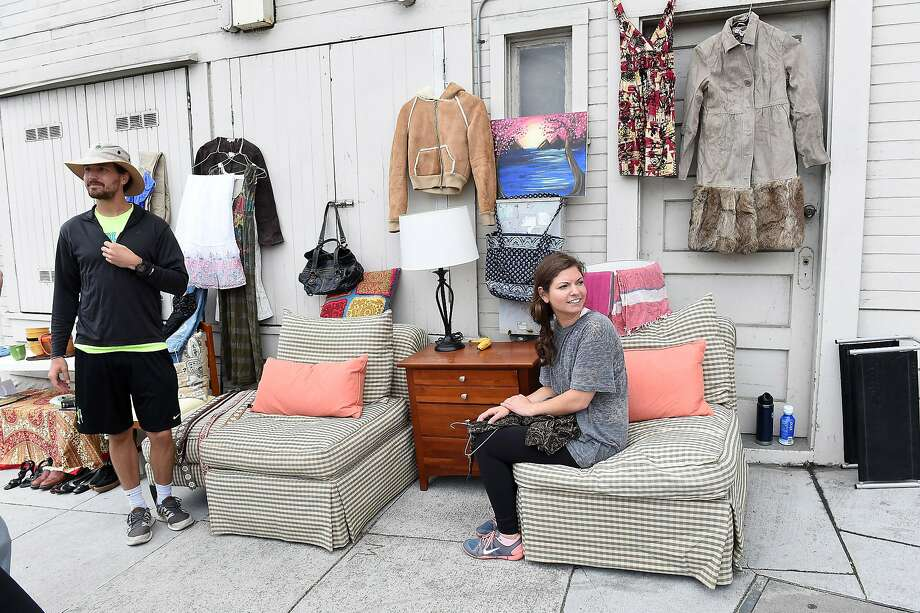 Matthias McCall and Kendall Ponger are seen at a garage sale on Cortland Avenue in Bernal Heights on Saturday, August 8, 2015. Over 100 participants held garage sales in the neighborhood. Photo: Susana Bates, Special To The Chronicle