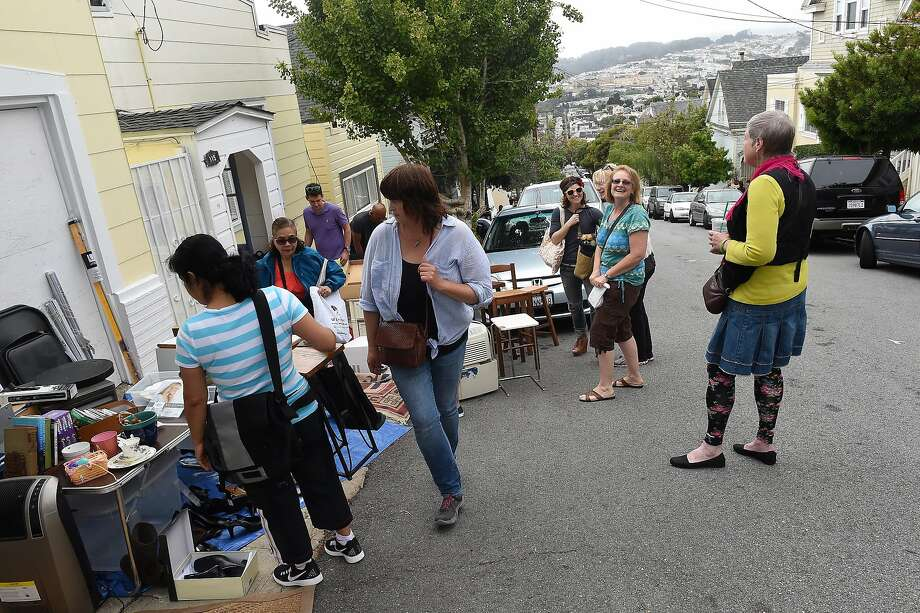 People are seen on Andover Street at the Hillwide Garage Sale in Bernal Heights on Saturday, August 8, 2015. Over 100 participants held garage sales in the neighborhood. Photo: Susana Bates, Special To The Chronicle