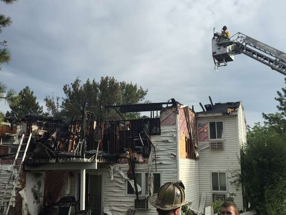Firefighters knock down a blaze at the Strawbery Ridge Apartments in Waterford Saturday Aug. 8. (Dartunorro Clark)