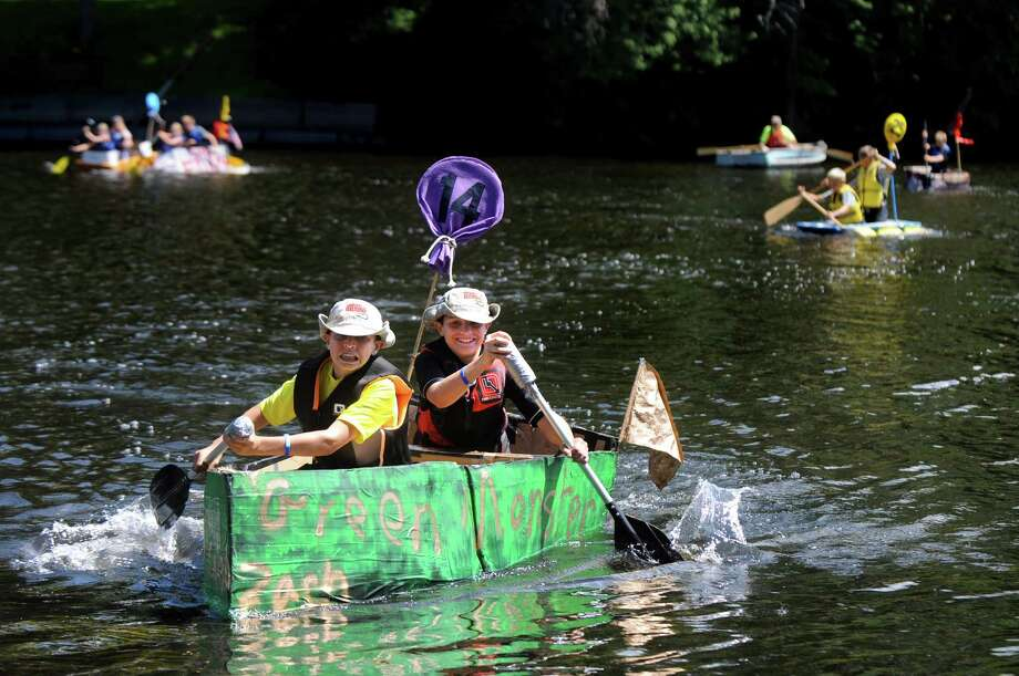 Friends Zach Golden, 12, left, and Caleb Dyer, 12, both of Stillwater, stay focused as they paddle the Green Monster into first in the kids' race during the 11th Annual Cardboard Boat Race to benefit Hudson Crossing Park on Saturday, Aug. 8, 2015, at Fort Hardy Beach in Schuylerville, N.Y. (Cindy Schultz / Times Union) Photo: Cindy Schultz / 00031416A