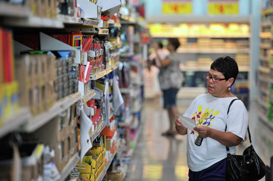 Esmerlda Salazar does some school supply shopping for her grandchildren Saturday at the 1601 Nogalitos HEB store. Photo: Robin Jerstad / San Antonio Express-News