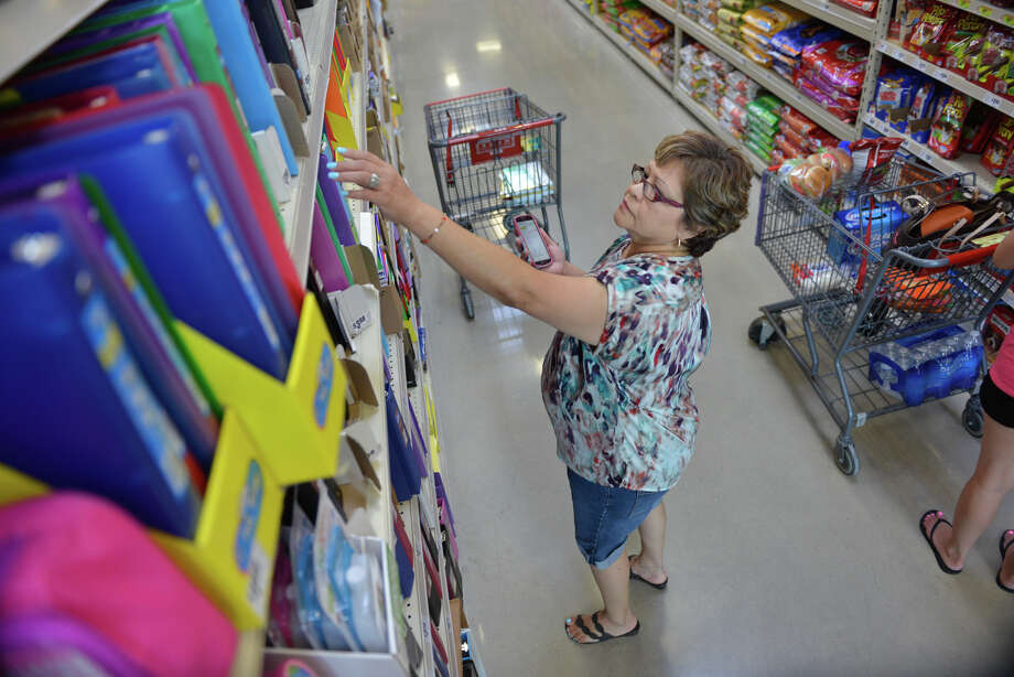 Janie Barragan does some school supply shopping for her grandchildren at a West Side H-E-B on Aug. 8. Texas sales tax revenue in the retail sector increased in August compared to the year before. Photo: Robin Jerstad /San Antonio Express-News