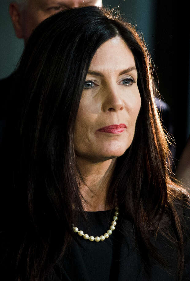 FILE - In this March 11, 2015 file photo, Pennsylvania Attorney General Kathleen Kane walks from the State Supreme Court room at City Hall in Philadelphia. Kane spokesman Chuck Ardo said Thursday, Aug. 6, 2015, that Kane is aware of reports she faces criminal charges. A grand jury recommended in December that Kane be charged in connection with allegations she unlawfully leaked information from a 2009 investigation. (AP Photo/Matt Rourke, File) ORG XMIT: BX101 Photo: Matt Rourke / AP