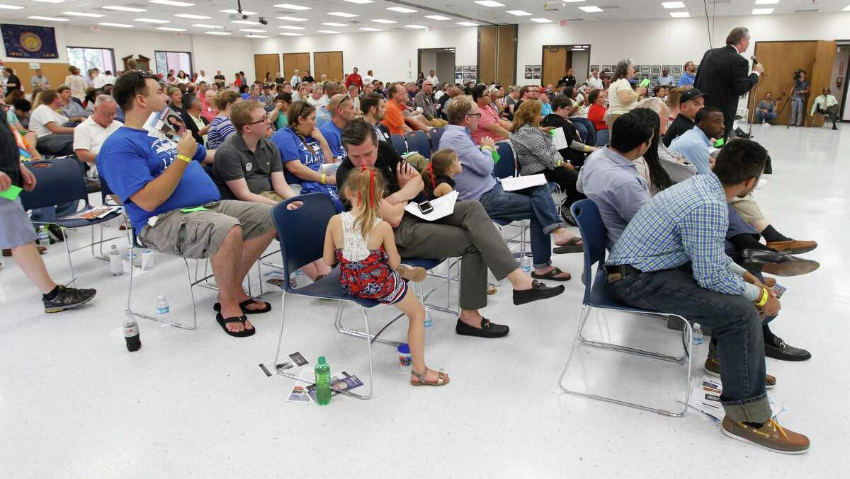 A large crowd takes their seats during the Houston GLBT Political Caucus at the IBEW Hall, where they picked their slate of mayoral, controller and city council candidates on Saturday, Aug. 8, 2015, in Houston. A large crowd of nearly 300 members, was a traditional caucus-style event, with all of the progressive mayoral candidates present.