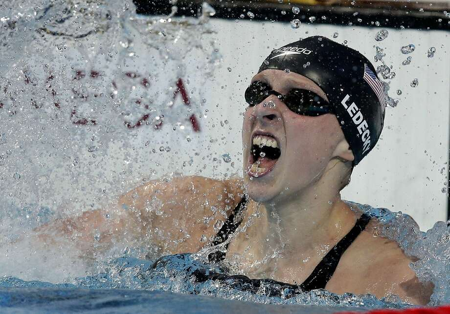 Katie Ledecky makes a splash after setting a world record in the women's 800-m eter freestyle. Photo: Michael Sohn, Associated Press