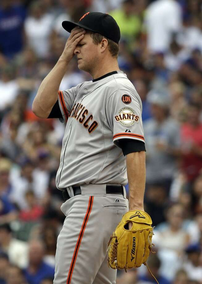 San Francisco Giants starter Matt Cain wipes his face after Chicago Cubs' Anthony Rizzo walked to first base during the first inning of a baseball game Saturday, Aug. 8, 2015, in Chicago. (AP Photo/Nam Y. Huh) Photo: Nam Y. Huh, Associated Press