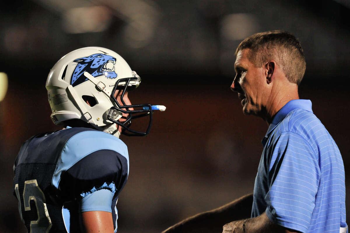 Johnson coach Ron Rittiman talks with his son, quarterback Hunter Rittiman during a timeout in 2013.