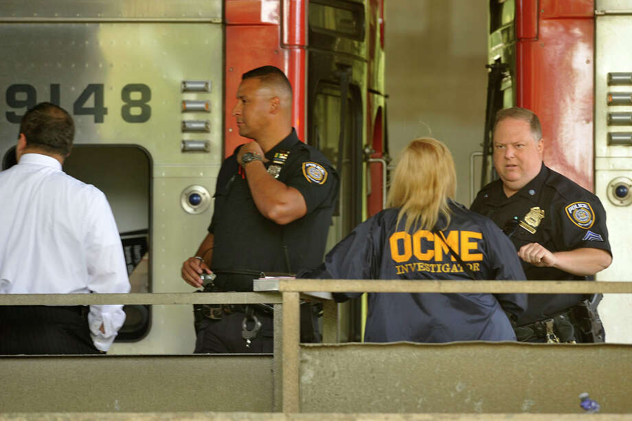 Metro Transit Authority personnel tend to the scene where a person was struck and killed by a train Friday morning near the Cos Cob train station in Greenwich, Conn., on Friday, Aug. 7, 2015. Photo: Jason Rearick / Hearst Connecticut Media / Stamford Advocate