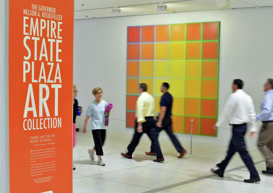 Workers and visitors walk past artwork on the concourse at the Empire State Plaza Tuesday July 14, 2015 in Albany, NY.  (John Carl D'Annibale / Times Union) Photo: John Carl D'Annibale / 00032594A