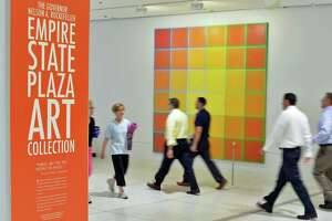 Workers and visitors walk past artwork on the concourse at the Empire State Plaza Tuesday July 14, 2015 in Albany, NY.  (John Carl D'Annibale / Times Union)
