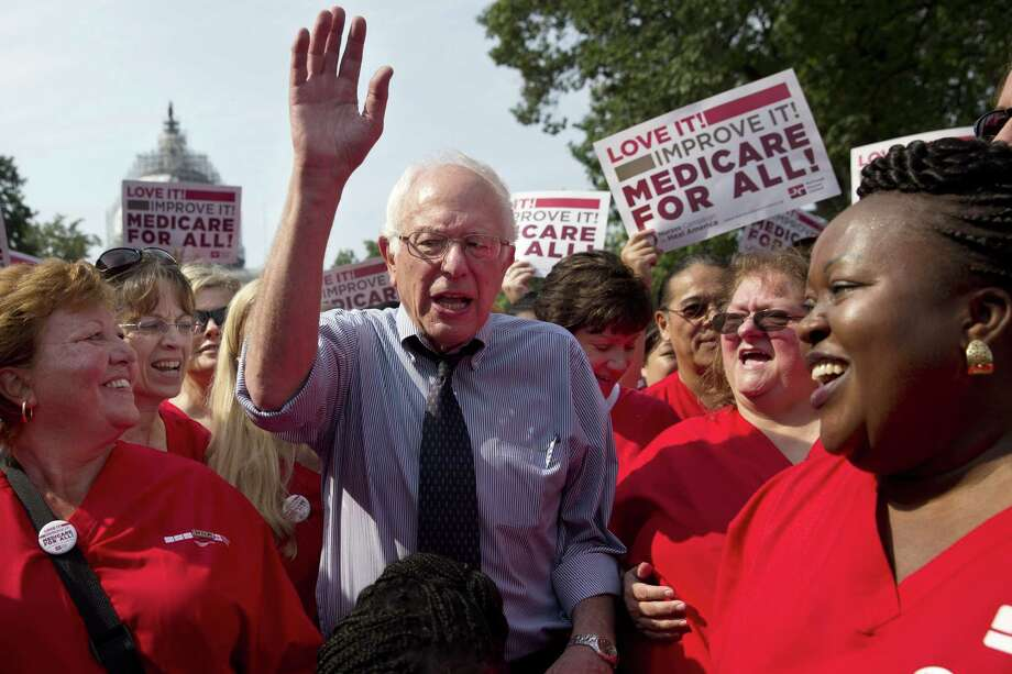 Democratic presidential candidate, Sen. Bernie Sanders, I-Vt., waves after speaking at a rally with registered nurses and other community leaders celebrate the 50th anniversary of Medicare and Medicaid, Thursday, July 30, 2015. on Capitol Hill Washington. (AP Photo/Jacquelyn Martin) ORG XMIT: DCJM102 ORG XMIT: MER2015080715242434 Photo: Jacquelyn Martin / AP