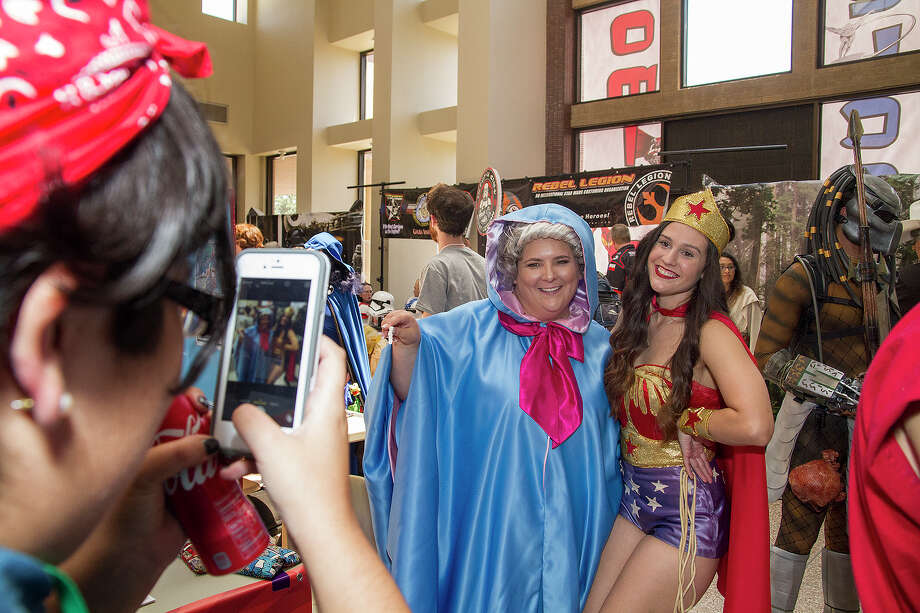 Samantha Alvarado takes a photo of Jennifer Mills dressed as the Fairy Godmother and Kristen Wong dressed as Wonder Woman, Saturday, August 8, 2015 at Texas Comicon at the Shrine Auditorium. Photo: Alma E. Hernandez, For The San Antonio Express News / Alma E. Hernandez / For The San