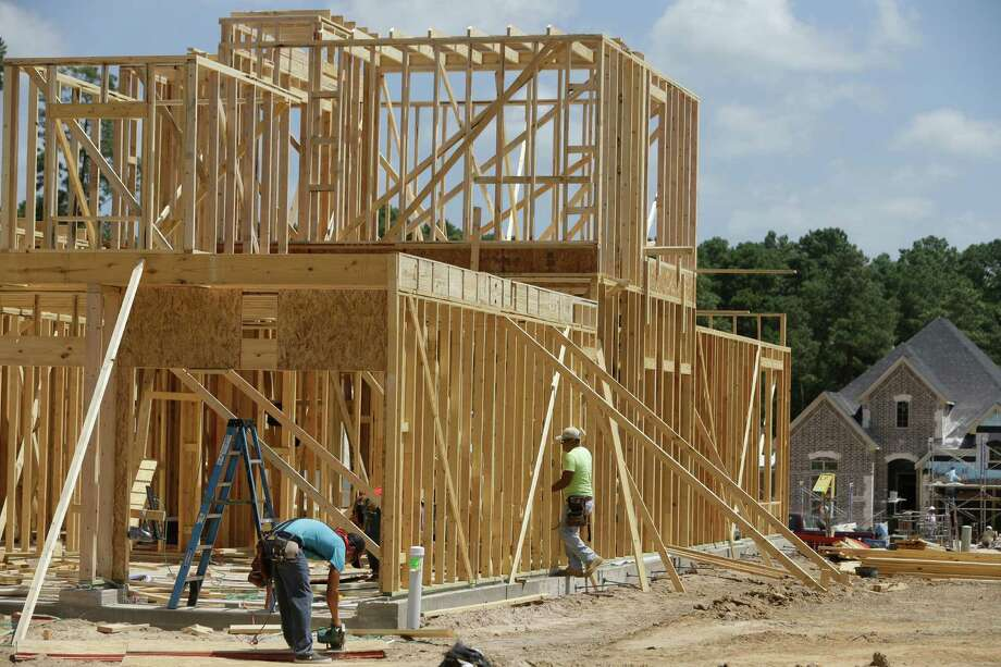 Construction is shown in the gated community of Woodtrace Thursday, Aug. 6, 2015, in Tomball. ( Melissa Phillip  / Houston Chronicle ) Photo: Melissa Phillip, Staff / © 2015 Houston Chronicle