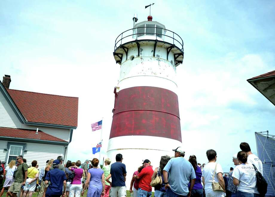 Hundreds of visitors wait in line, some up to three hours, Saturday, Aug. 8, 2015, during an open house at Stratford Point Lighthouse. Photo: Autumn Driscoll / Hearst Connecticut Media / Connecticut Post