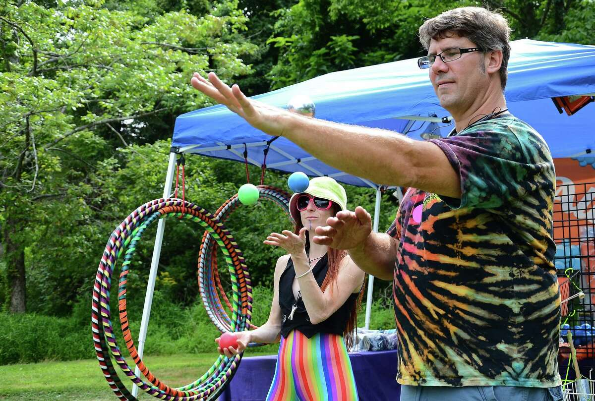 """Tricia """"Evolution Belle"""" Storie and Michael Sauvageau during a juggling demo at the fourth annual Reggae Festival at Ives Concert Park in Danbury, Conn., on Saturday, Aug. 8, 2015."""