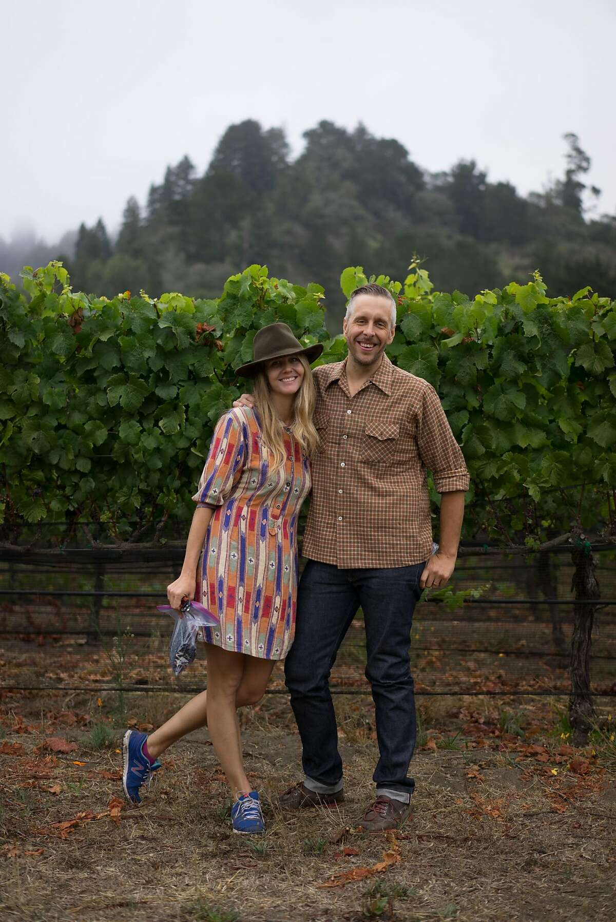 Emily Virgil, left, and Drew Huffine pose for a photo in Aptos, Calif. on Saturday, Aug. 8, 2015. Virgil and Huffine both have daytime jobs but hope to make winemaking their full-time business.