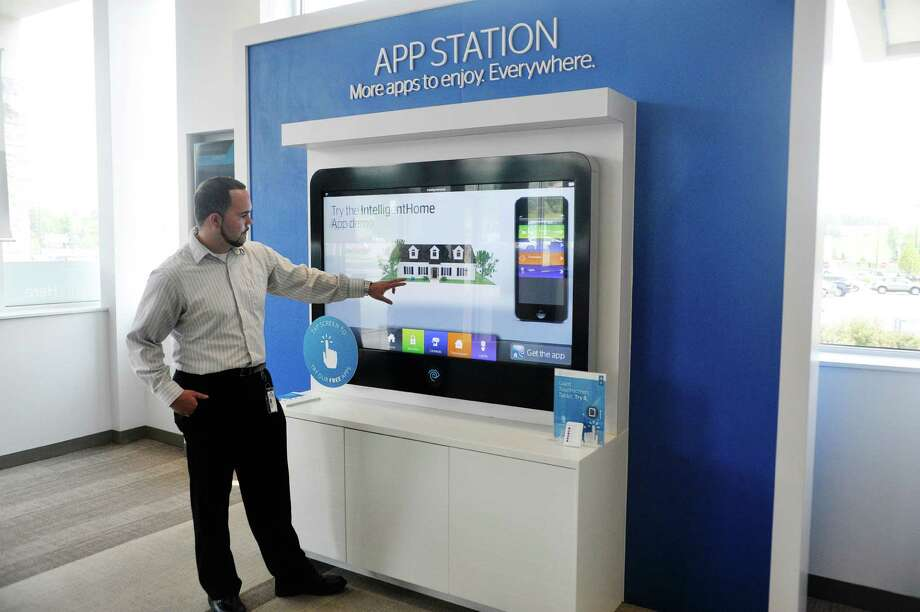 Nathan Bradbury, the Time Warner Cable retail sales supervisor at the Troy Time Warner Cable Experience Center, demonstrates some of the products the cable company can offer its customers, at the Troy Time Warner Cable Experience Center on Monday, July 13, 2015, in Troy, N.Y.  (Paul Buckowski / Times Union) Photo: PAUL BUCKOWSKI / 00032583A