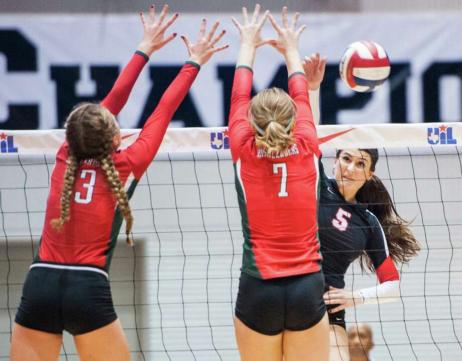 Churchill's Abby Buckingham (5) and The Woodlands' Hailey Reier (3) and Hannah Hickman (7) during their UIL Class 6A state semifinal volleyball match on Nov. 21, 2014 at the Curtis Cullwell Center in Garland. Photo: Ashley Landis /For The Express-News / ***NOT FOR RESALE***