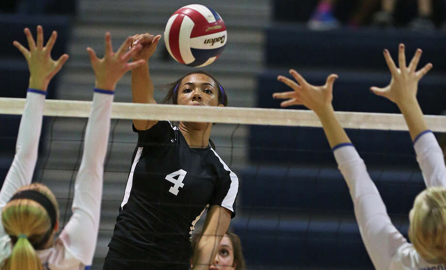 Steele's Jada Gardner finds a hole in the defense as New Braunfels hosts Steele in volleyball on Sept. 23, 2014. Photo: Tom Reel /San Antonio Express-News / San Antonio Express-News