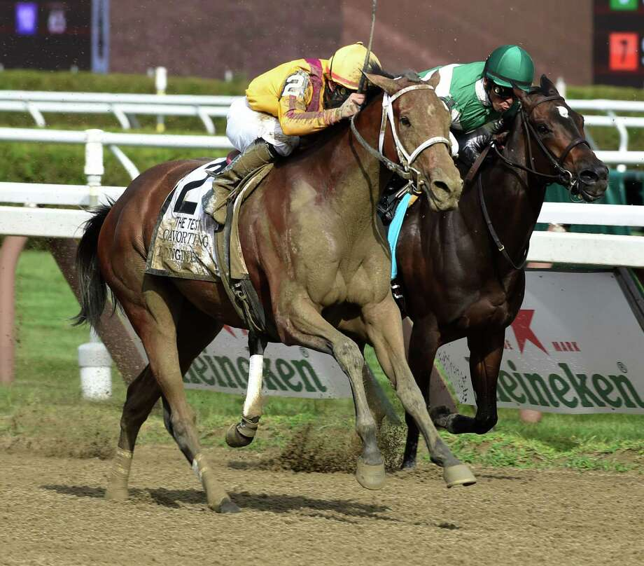 Cavorting wins the 90th running of the Test Stakes at Saturday afternoon Aug. 8, 2015 at the Saratoga Race Course in Saratoga Springs, N.Y.  (Skip Dickstein/Times Union) Photo: SKIP DICKSTEIN