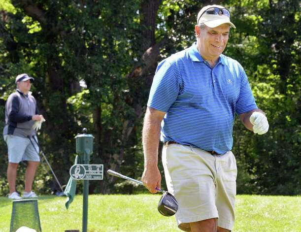 Dan Russo, right, of Hagaman is all smiles after teeing off on the tenth hole in final round of the Capital Stroke Play, the signature event of the Capital Region Amateur Golf Association at Schuyler Meadows Club Saturday August 8, 2015 in Colonie, NY.  (John Carl D'Annibale / Times Union) Photo: John Carl D'Annibale / 00031865A