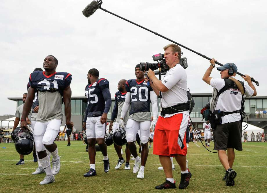 Houston Texans defensive back Charles James (31) sings as he is followed to practice by a Hard Knock film crew during Texans training camp with the Washington Redskins at the Bon Secours Training Center on Thursday, Aug. 6, 2015, in Richmond, Va.  ( Brett Coomer / Houston Chronicle ) Photo: Brett Coomer, Staff / © 2015 Houston Chronicle