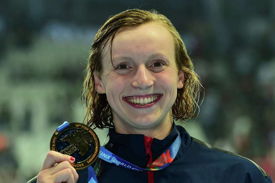 USA's gold medallist Katie Ledecky poses on the podium the final of the women's 800m freestyle swimming event at the 2015 FINA World Championships in Kazan on August 8, 2015        AFP PHOTO / CHRISTOPHE SIMONCHRISTOPHE SIMON/AFP/Getty Images ORG XMIT: 564886639 Photo: CHRISTOPHE SIMON / CHRISTOPHE SIMON