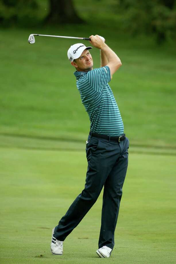 AKRON, OH - AUGUST 08: Justin Rose of England plays his third shot on the 16th hole during the third round of the World Golf Championships - Bridgestone Invitational at Firestone Country Club South Course on August 8, 2015 in Akron, Ohio.  (Photo by Richard Heathcote/Getty Images) ORG XMIT: 527945551 Photo: Richard Heathcote / 2015 Getty Images