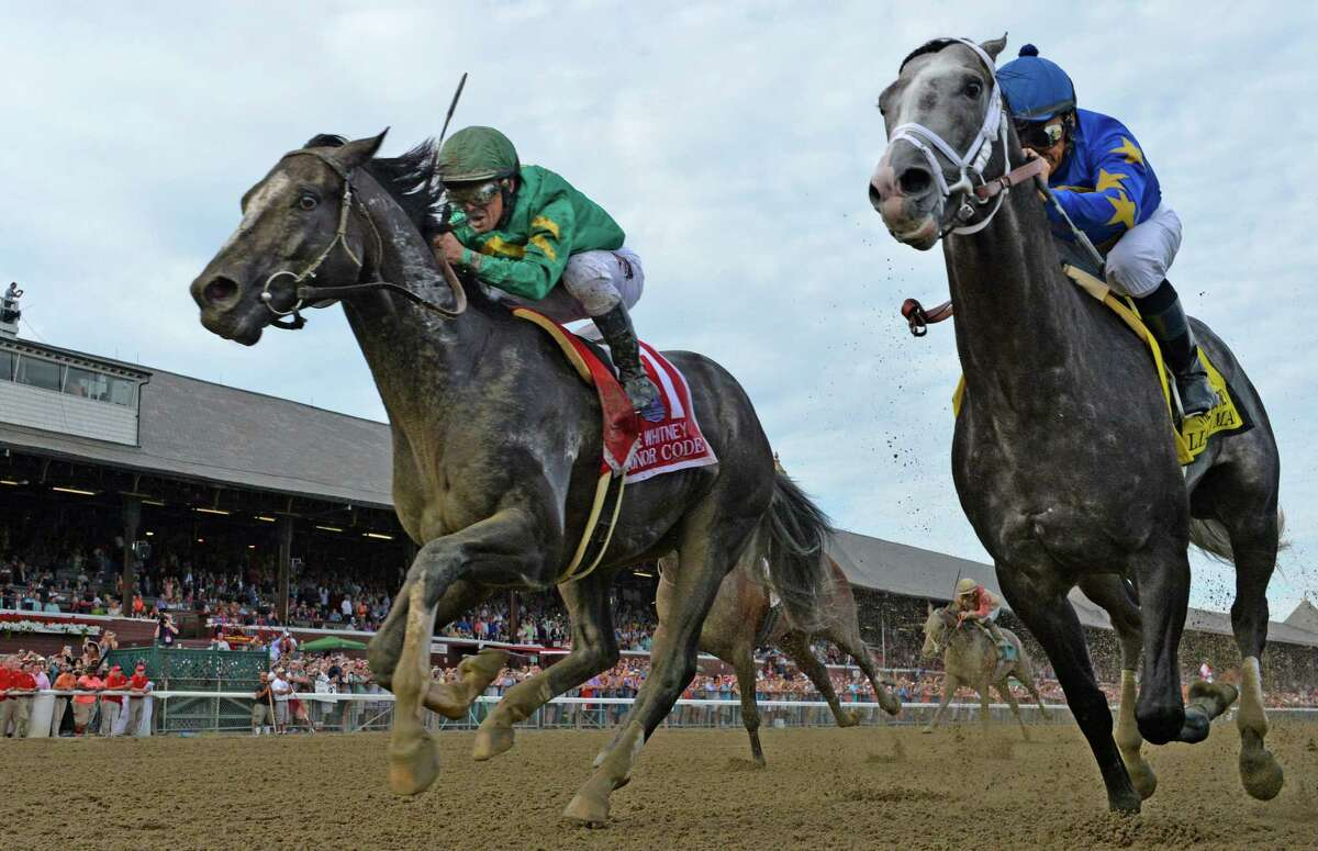 Honor Code ridden by jockey Javier Castellano, left catches Liam's Map with jockey Mike Smith at the wire Saturday Aug 8, 2015 to win the 88th running of the Whitney at the Saratoga Race Course in Saratoga Springs, N.Y. (Skip Dickstein/Times Union)