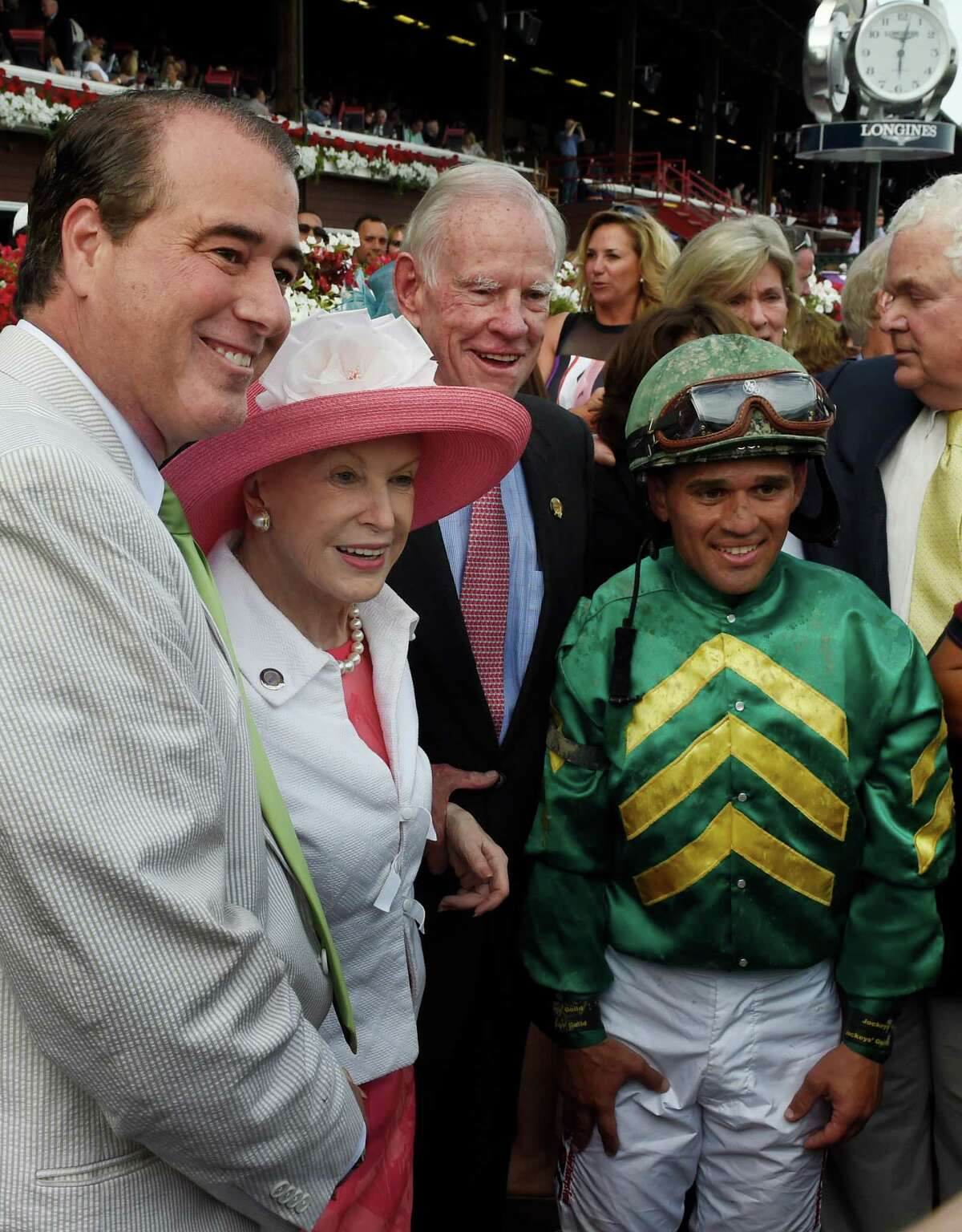 John Hendrickson, left stands with wife Marylou Whitney and winner Honor Code's owner Will Farish and jockey Javier Castellano Saturday Aug 8, 2015 after the 88th running of the Whitney at the Saratoga Race Course in Saratoga Springs, N.Y. (Skip Dickstein/Times Union)