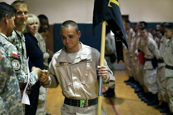 Cadet Andrew Bell gets a fist bump as he was selected to carry his platoon's guidon, during an awards ceremony June 11. Cadets wake up at 4:45 for physical fitness training before heading off to do school work.